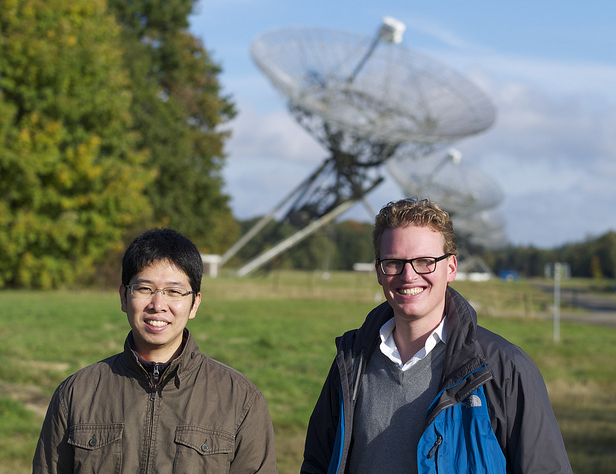 Yusik Kim (left) and Rik Jongerius, scientists at the ASTRON & IBM Center for Exascale Technology. Behind them is the Westerbork telescope in The Netherlands